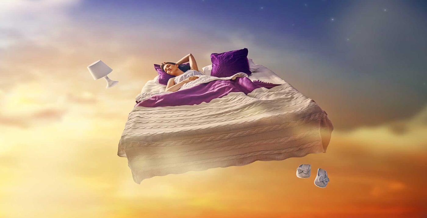 Banner Fliegendes Bett mit Frau